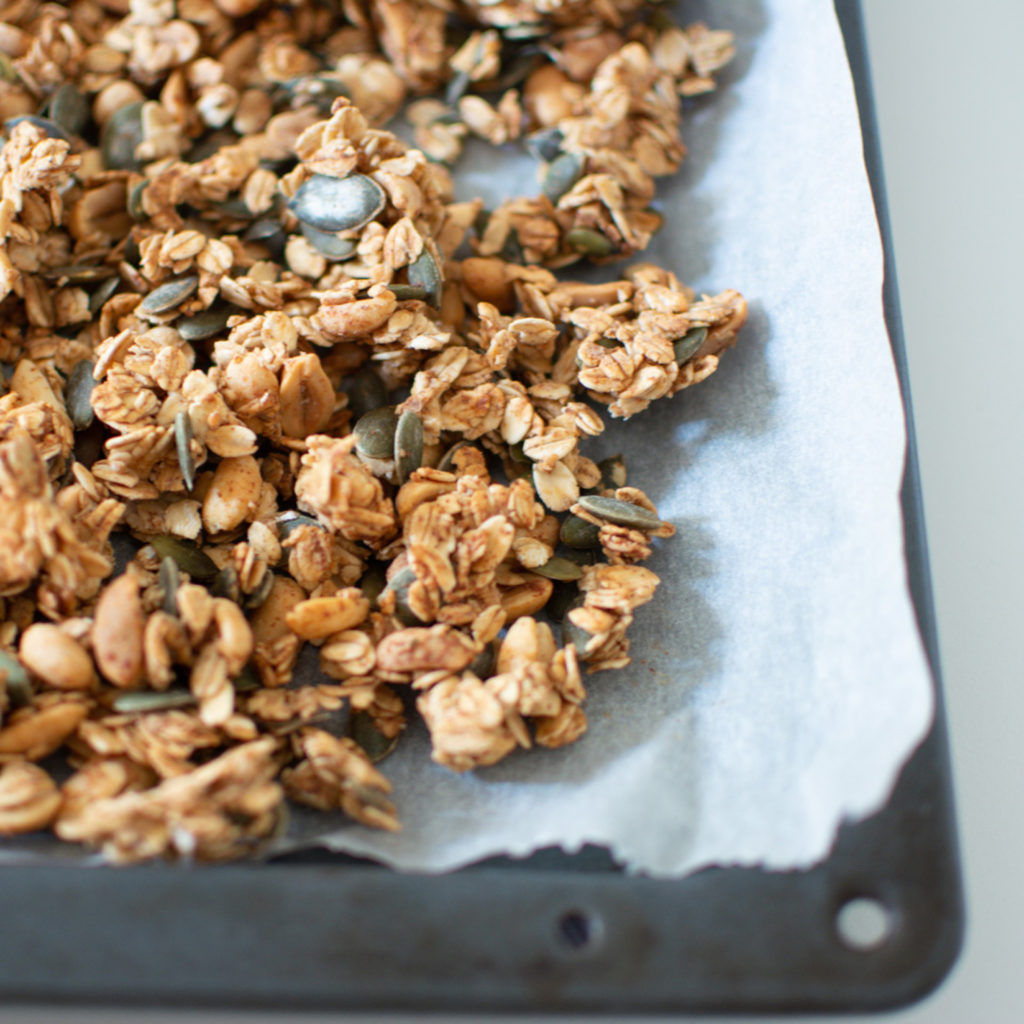 Granola in a lined baking sheet