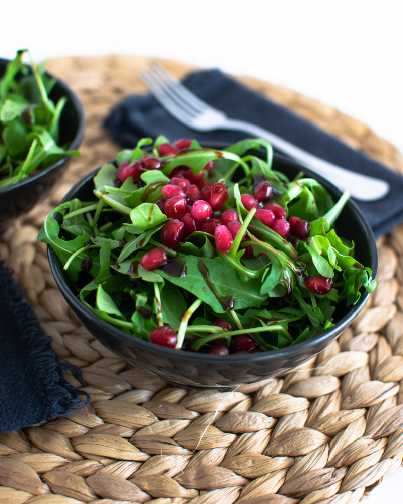 Bowl of rocket and pomegranate arills